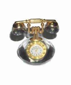 Ceas din cristal multifatetat, cu elemente metalice aurii