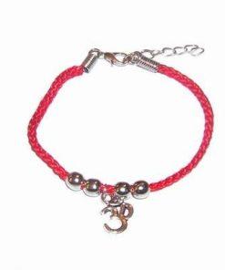 Bratara pe siret rosu cu simbolul Tao/OM din metal nobil
