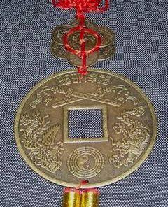 Moneda antica cu pasarea Phoenix si Dragon