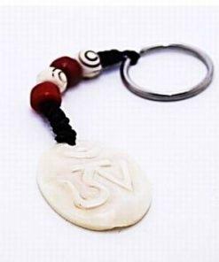 Breloc cu simbolul Tao/Om sculptat in os, alb
