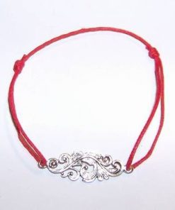Bratara pe siret rosu, reglabil, cu simbol celtic din argint